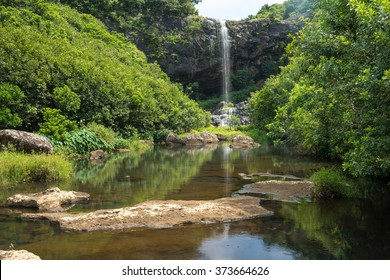 Nice view of the waterfalls of the island of Mauritius, surrounded by green forests and mountains