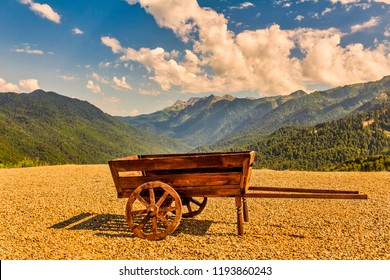 Nice vintage wooden cart with ocean coastline background, Oia, Santorini, Greece,wooden cart on the background of mountains