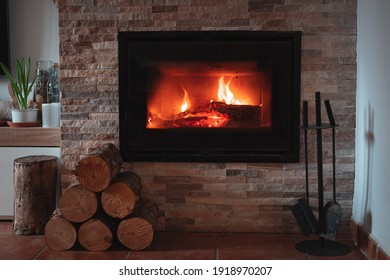 Nice and warm Fireplace with small logs Near of it in cold Winter
