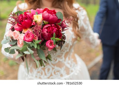 nice wedding bouquet in bride and groom hand