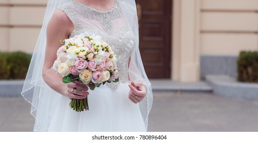 Nice wedding bouquet in bride's hand Wedding bouquet from roses