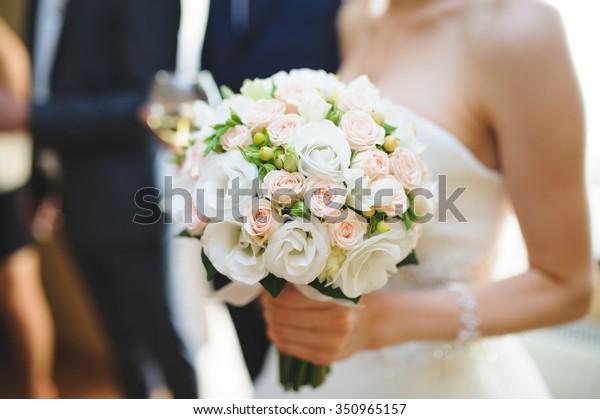 nice wedding bouquet in bride's hand