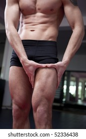 Nice well build man's body. Young man in gym.