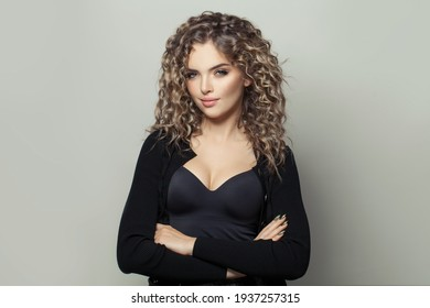 Nice woman with curly hairstyle on white background