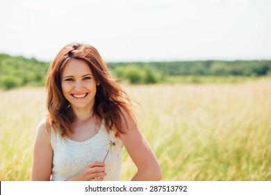 nice woman enjoy summer in the field