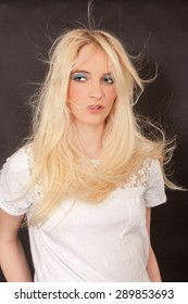 Nice woman with flying long blond hair. Studio admission with black background. / Nice woman with flying long hair