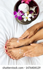 Nice woman getting fingernail manicure and toenail pedicure. Beautiful female legs and hands with nails taking treatment in spa salon
