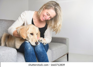 A nice woman with her golden Retriever dog