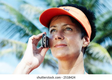 nice woman making an oversea  phone call from resort