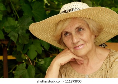Nice woman sitting on the veranda of her cottage