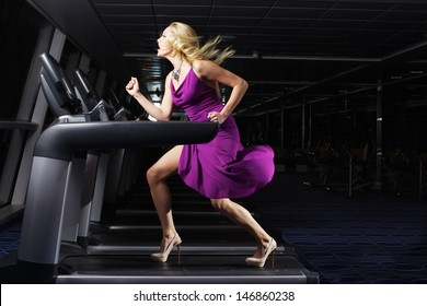 The nice women in beautiful dress indoors the gym