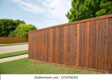 Nice wooden fence around house - Shutterstock ID 1715706331
