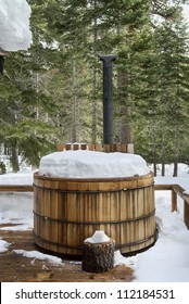 Nice wooden hot tub covered with snow, winter background, northern california