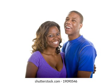 A nice young black couple holding each other and laughing