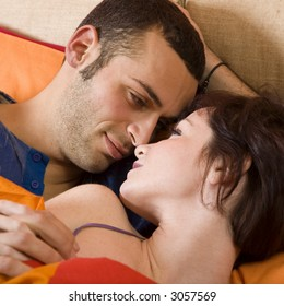 nice young couple laying on the bed
