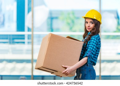 Nice young woman carrying box