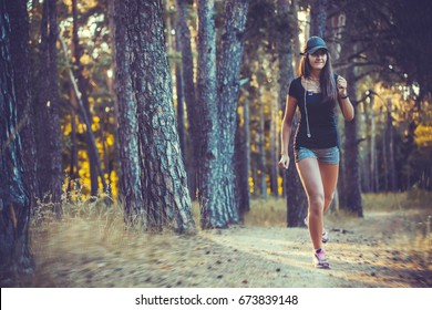 nice young woman on morning joging in a summer forest