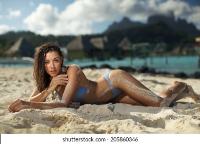 Nice young woman is stand in the ocean