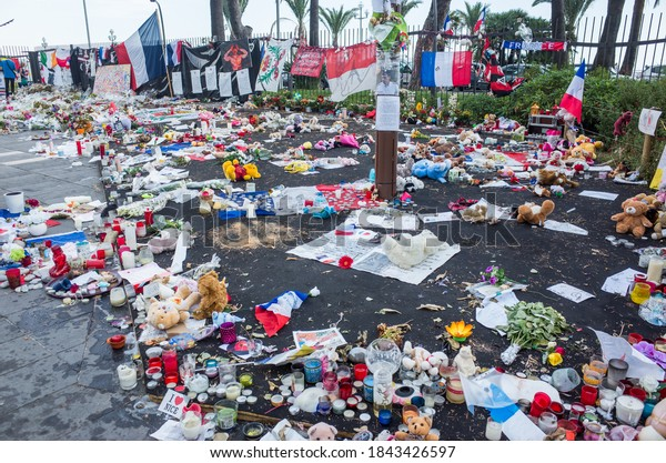 NICE,FRANCE -  JULY 26:  nice habitants and tourist  keep bringing  flowers and dolls to remember the victims of the terrorist attack of the 14th july , in the promenade des anglais.
