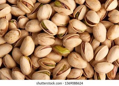 Nicely baked pistachio in closeup detail with visible seeds and shells
