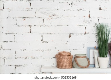 Nicely decorated shelf against brick wall