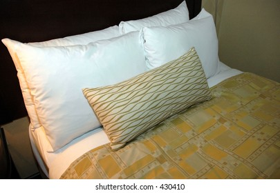 Nicely made bed in hotel room