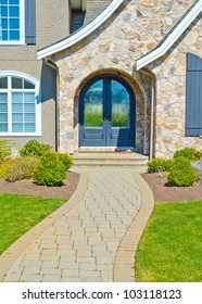 Nicely paved and designed doorway. Entrance to the house.