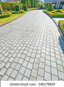 Nicely paved long driveway, trail, sidewalk, path. North America.