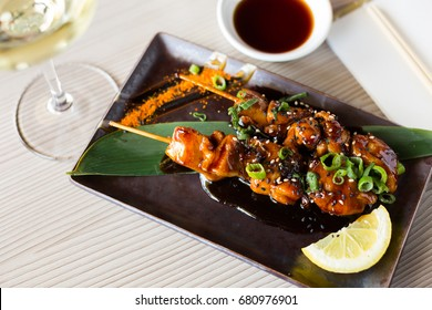 Nicely served japanise style meal yakitori with soya souse