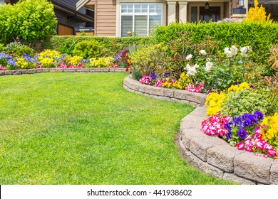 Nicely trimmed and manicured garden in front of a luxury house in Canada.