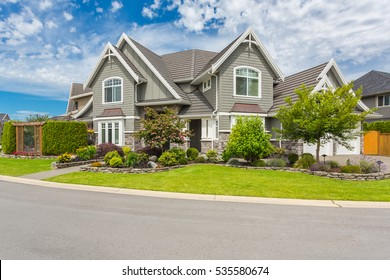 Nicely trimmed and manicured garden in front of a luxury house.