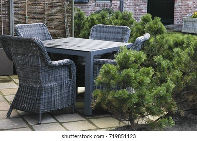 niche with nice dark grey or black rattan furniture for the corner and a pine