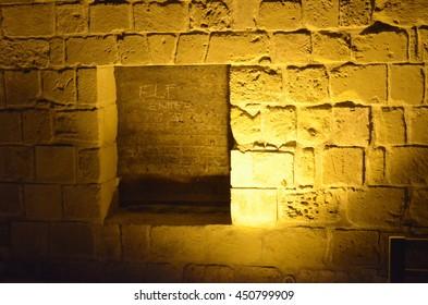 niche spot light brick wall