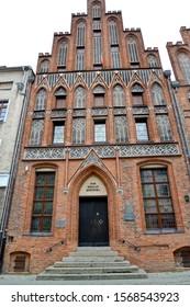 Nicholas Copernicus House (15th century). Torun, Poland. Polish text - Nicholas Copernicus House