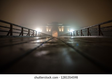 Nicholas gate of Daugavpils Fortress in fog at night