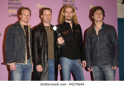 NICKELBACK at the 2002 Billboard Music Awards at the MGM Grand, Las Vegas. 09DEC2002.  Paul Smith / Featureflash