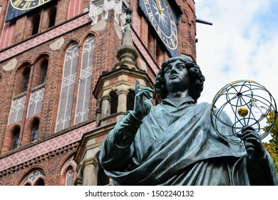 The Nicolaus Copernicus Monument in Torun - home town of astronomer Nicolaus Copernicus. Statue in front of the Old Town Hall, Torun, Poland.
