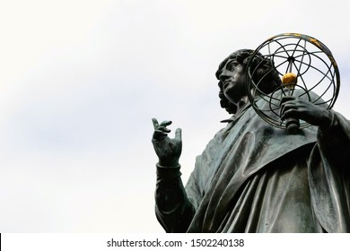 The Nicolaus Copernicus Monument in Torun - home town of astronomer Nicolaus Copernicus. Torun, Poland.  Close up, place for text