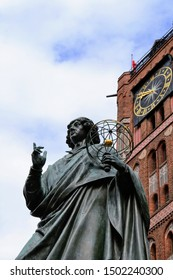 The Nicolaus Copernicus Monument in Torun - home town of astronomer Nicolaus Copernicus. Torun, Poland.  left hand holds an astrolabe