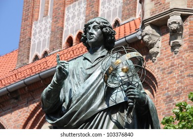 Nicolaus Copernicus statue in Torun, Poland. Copernicus was the first person to formulate a comprehensive heliocentric cosmology which displaced the Earth from the center of the universe.
