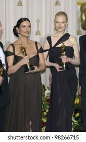NICOLE KIDMAN (right) & CATHERINE ZETA-JONES at the 75th Academy Awards at the Kodak Theatre, Hollywood, California. March 23, 2003
