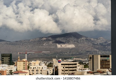 Nicosia, Nicosia / Cyprus - 05 08 2018: Mountain with Turkish flags which, after the invasion of 1974, divides Cyprus into two parts. The part of the city belong to the Greek Cypriot area.