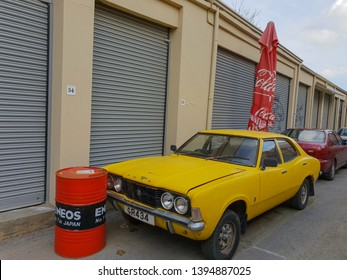 Nicosia, Cyprus - 19 January, 2019: A classic yellow Ford Cortina TC Mark III car is parked in an alley in the old town of Nicosia, Cyprus