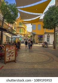 NICOSIA, CYPRUS - APRIL 2018: The outdoor cafes of the Faneromeni Square. Tourist sign near Lokmaci/Ledra border crossing in Nicosia, Cyprus, Europe.