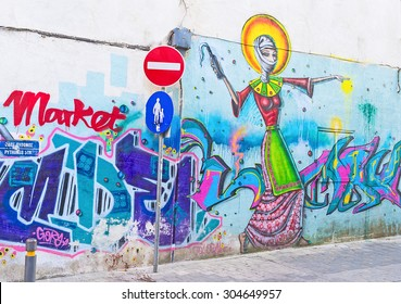 NICOSIA, CYPRUS - AUGUST 4, 2014: The graffiti depicting the young muslim woman with the Molotov cocktail in her hand, on August 4 in Nicosia.