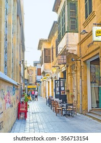 NICOSIA, CYPRUS - AUGUST 4, 2014: The narrow street in Laiki Geitonia neighborhood is the best place to relax in the outdoor cafe, on August 4 in Nicosia.