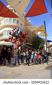 NICOSIA, CYPRUS - JANUARY 14, 2018: Tourists walking in Ledra street with cafes, bars, souvenir shops and boutiques in Nicosia, Cyprus. Ledra street connecting the 2 sides of Nicosia (Lefkosia)