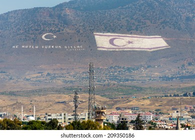 NICOSIA, CYPRUS - JUNE 3, 2014: Flag  of the Turkish Republic of Northern Cyprus overlooks the Cypriot capitol on June 3, 2014. With 805,400 square feet, it is the larger national flag in the world.