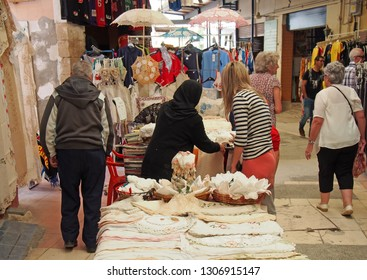 Nicosia, Cyprus - March 17, 2018: stallholders and shopper looking at traditional fabric and lacework in the traditional open market in the turkish area of Nicosia Cyprus