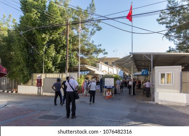 Nicosia, Cyprus, November 08, 2017: Local people and tourist are passing the border passport control checkpoint between northern (turkish) and southern (greek) parts of the city